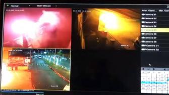 متطرفون يشعلون النار بالقرب من احد المحلات التجارية في الرينة